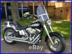 Harley Davidson Heritage/FatBoy OEM height 20 Lexan poly. Light tint windshield